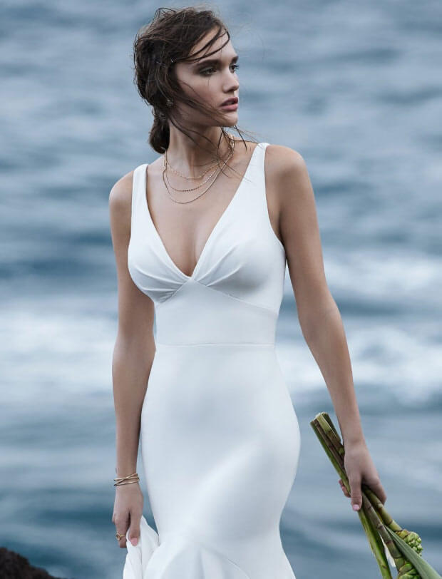 Model wearing a white Classic Gown