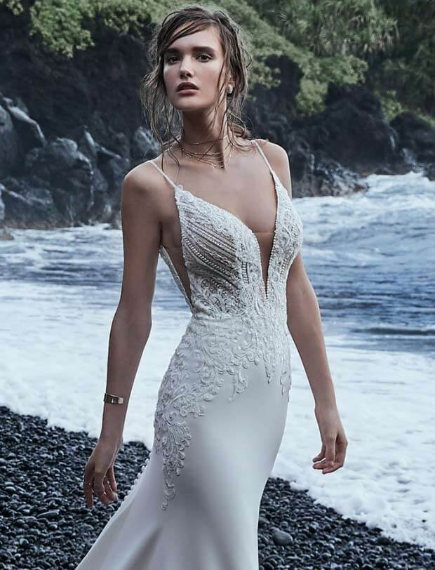 Model wearing a white Sophisticated Sleeves Gown